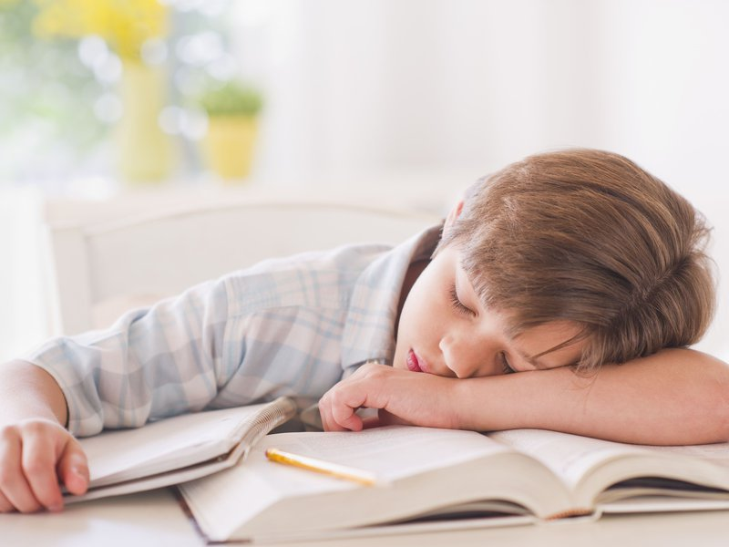 Getty_boy_sleeping_on_books_tired.jpg
