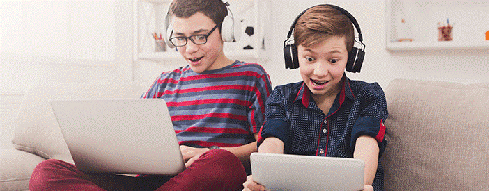 kids playing on laptop.png