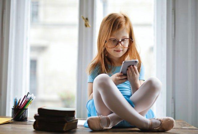 little girl using cell phone.jpg